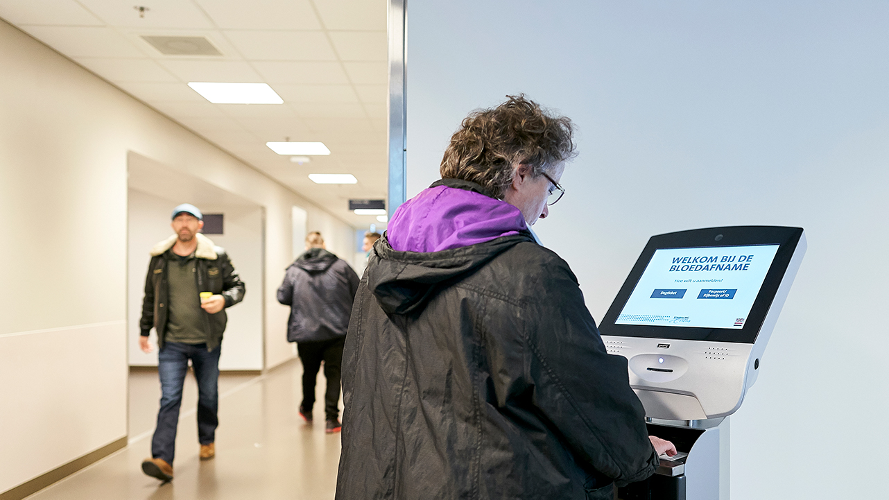 Check in at the self check-in point at the patient lab